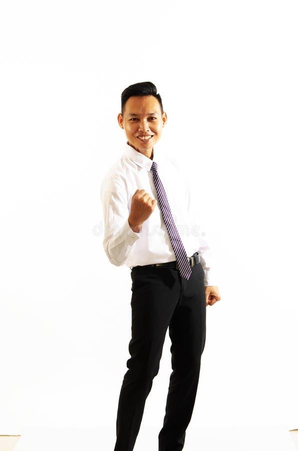 给在白色背景的亚裔商人拳头 图库摄影
