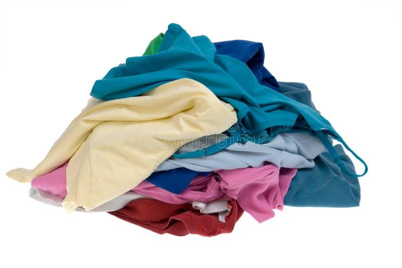 给坏的洗衣店堆穿衣 免版税库存照片