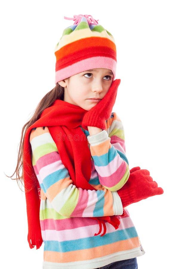 给女孩哀伤的冬天穿衣 免版税库存照片