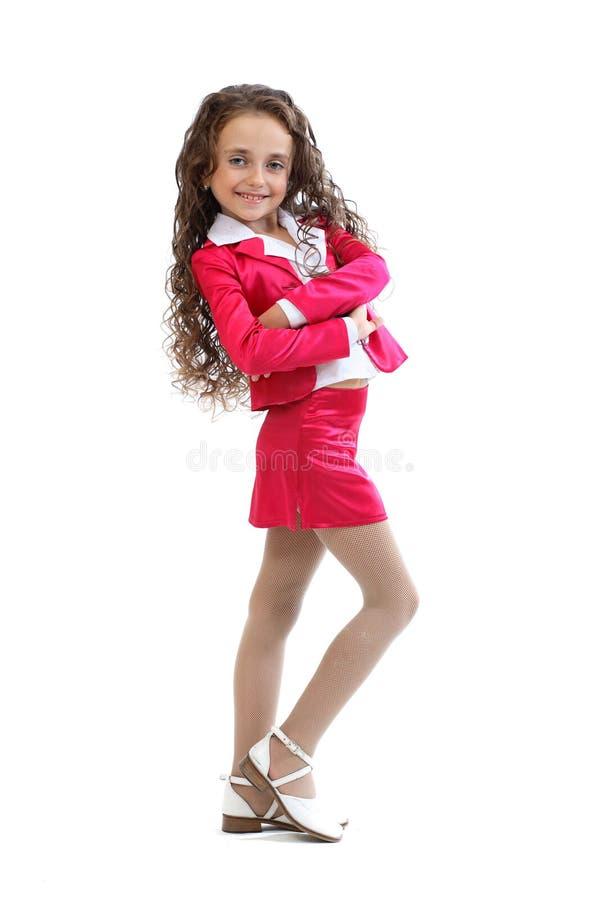 给女孩流行粉红年轻人穿衣 库存照片