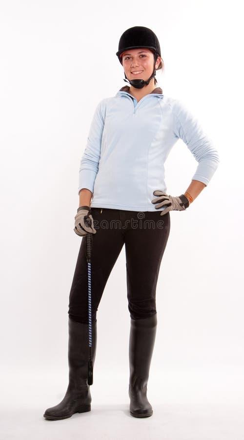 给女孩骑马穿衣 免版税库存照片