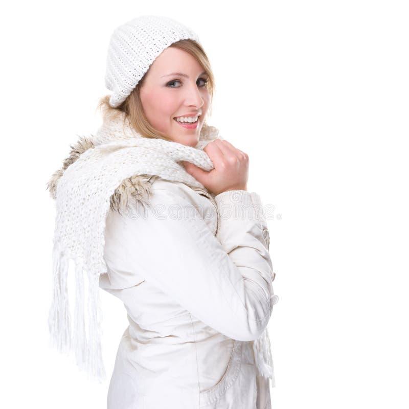 给白冬天妇女穿衣 免版税图库摄影