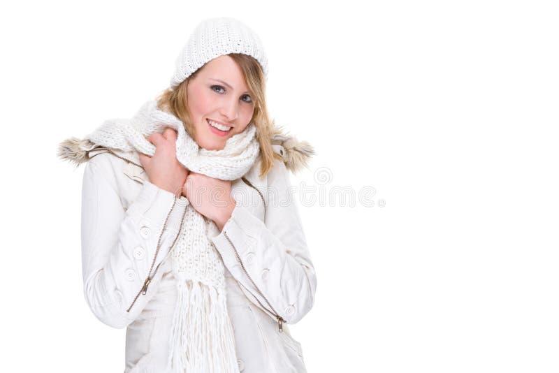 给白冬天妇女穿衣 库存照片