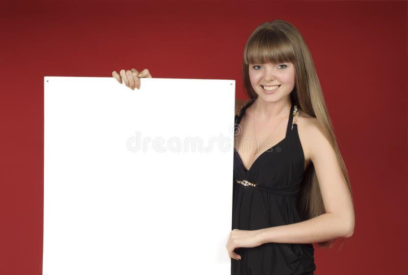 给白肤金发的俏丽的页做广告 图库摄影
