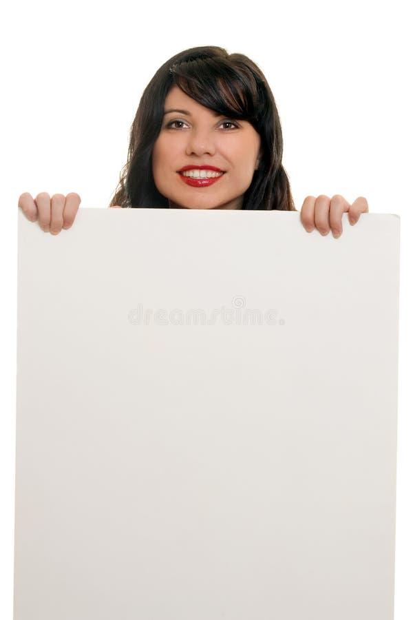给符号微笑的妇女做广告 免版税库存图片
