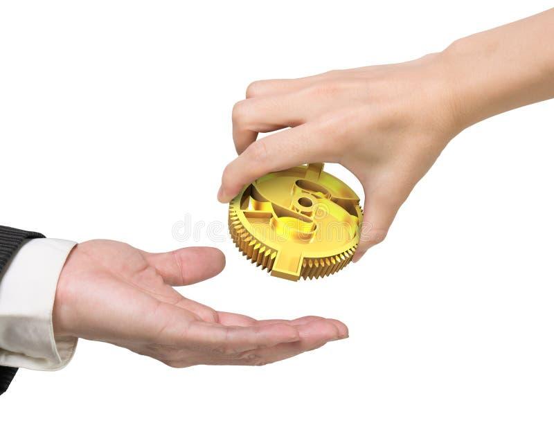 给货币符号齿轮的妇女手人手 免版税库存图片