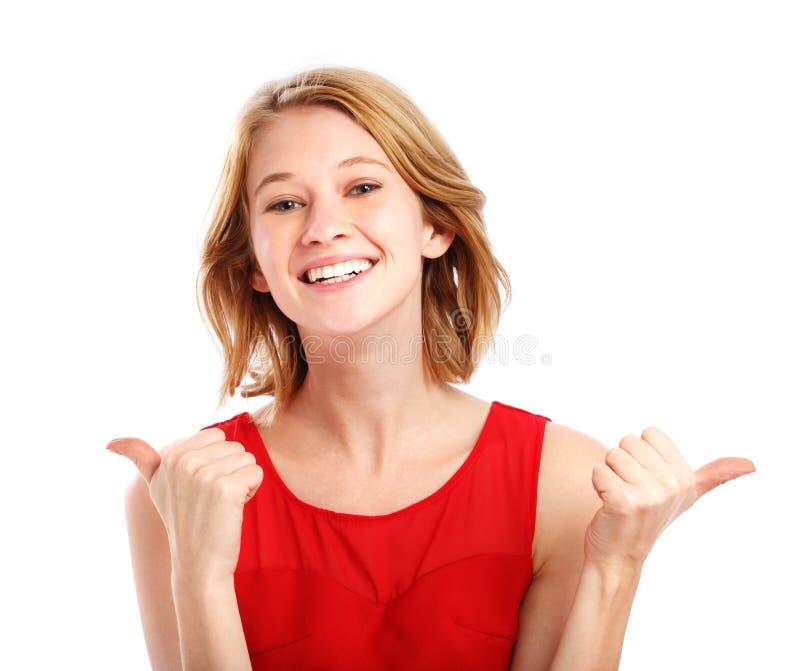 给赞许的愉快的少妇 免版税库存图片
