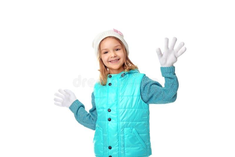 给逗人喜爱的女孩穿衣温暖的一点 免版税图库摄影