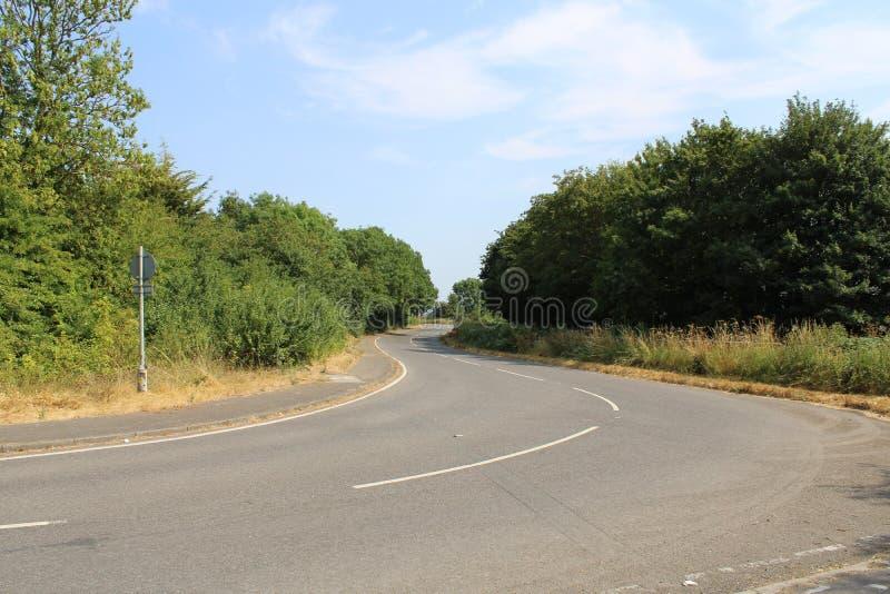 绞的空的乡下公路在农村艾塞克斯 图库摄影