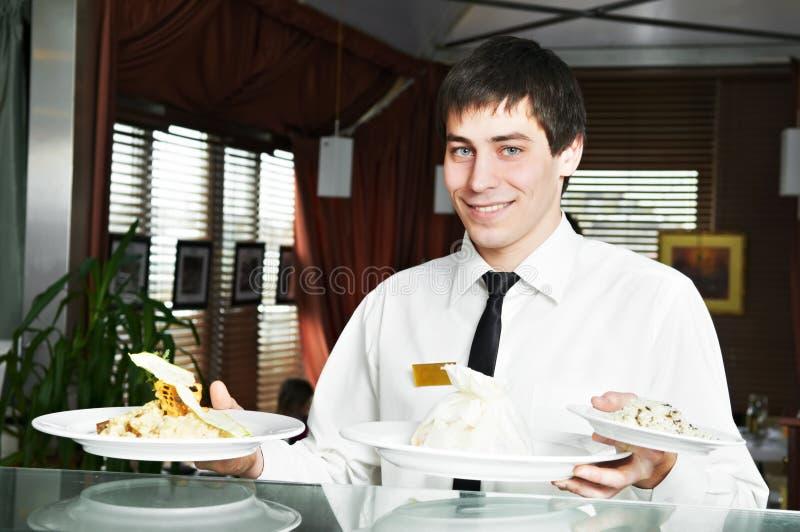 统一的等候人员在餐馆 免版税图库摄影