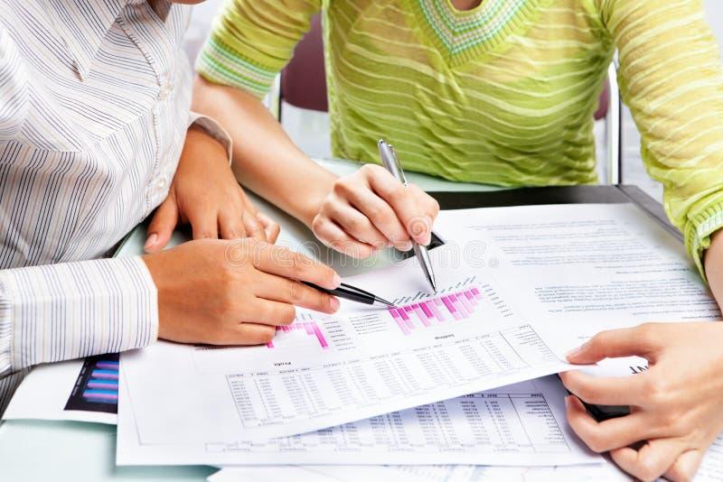 统计数据二妇女工作 免版税库存照片