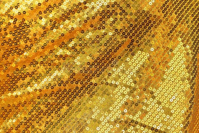 绣金的闪烁的衣服饰物之小金属片背景 皇族释放例证