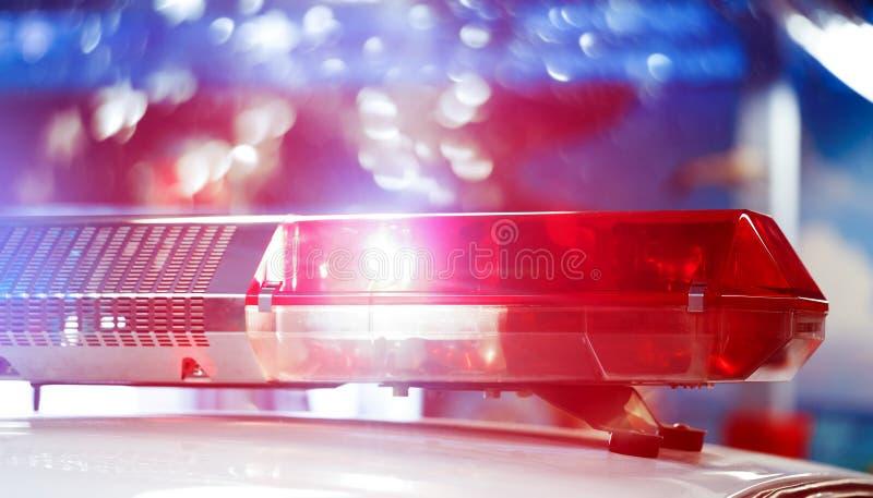 维持专业团结的巡逻车治安在夜间的 再 免版税库存照片