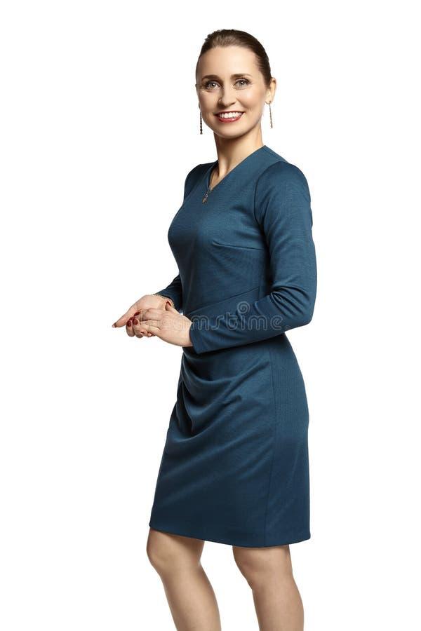 绿松石礼服的妇女 免版税库存照片