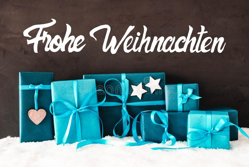 绿松石礼物,书法Frohe Weihnachten意味圣诞快乐 免版税库存图片