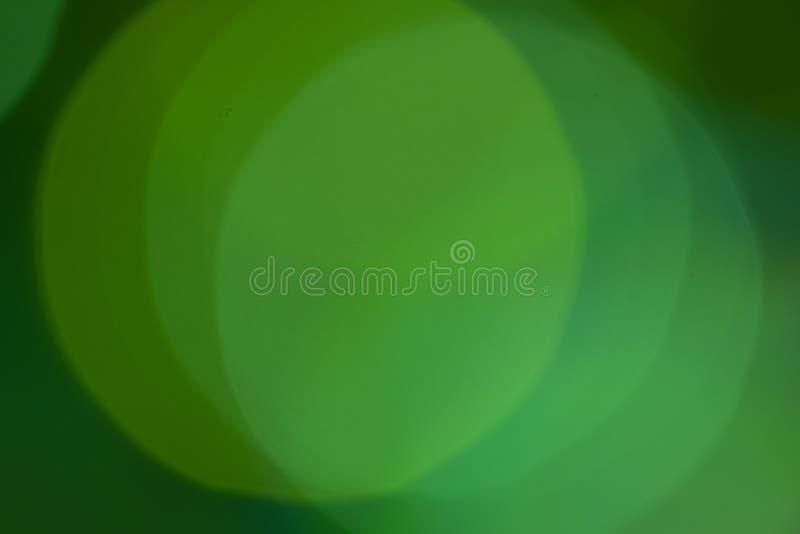绿灯bokeh背景与聚焦的摘要纹理 库存照片