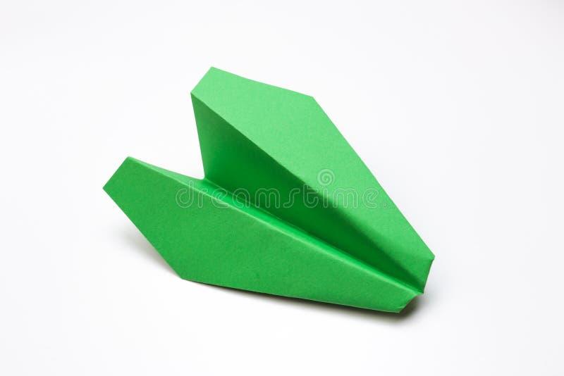绿皮书飞机平的位置在白色背景的与文本空间 免版税库存照片