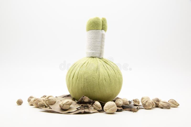 绿色压缩球和草本在白色背景 免版税图库摄影