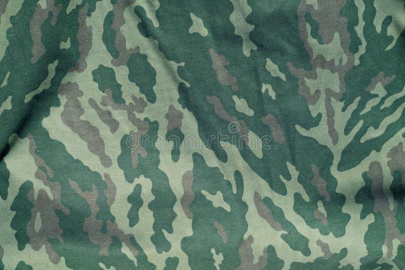 绿色和棕色军事伪装一致的样式 皇族释放例证