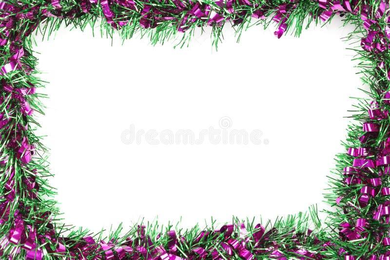 绿色圣诞节混合紫罗兰色颜色缨子在白色背景的 免版税图库摄影