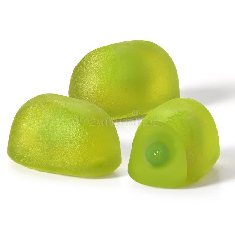 绿色在白色背景的果子耐嚼的糖果 免版税图库摄影