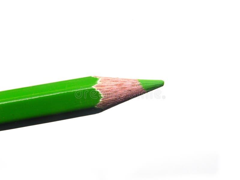 绿色在白色背景的铅笔技巧 库存图片