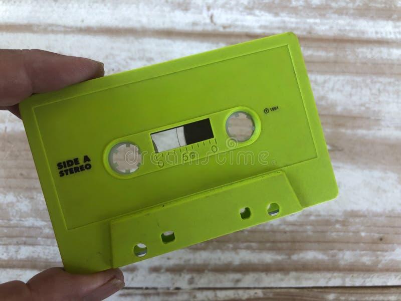 绿色塑料盒式磁带,约会1991年 免版税库存图片
