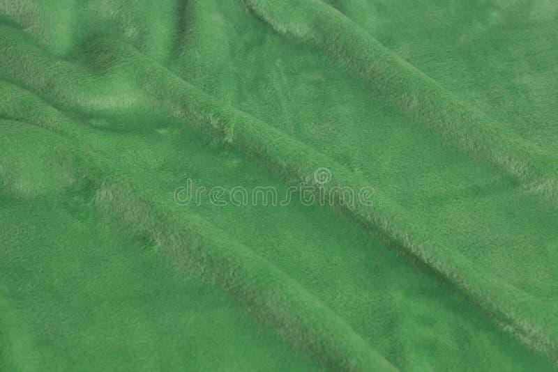 绿色天鹅绒织品背景纹理 库存图片