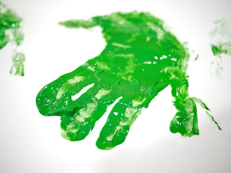 绿色孩子handprint绘画 图库摄影