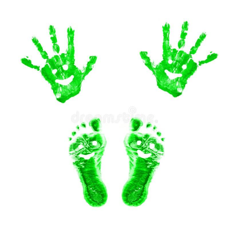 绿色微笑的脚印和handprints 库存图片