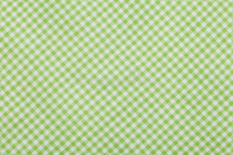 绿色方格的桌布背景 免版税图库摄影