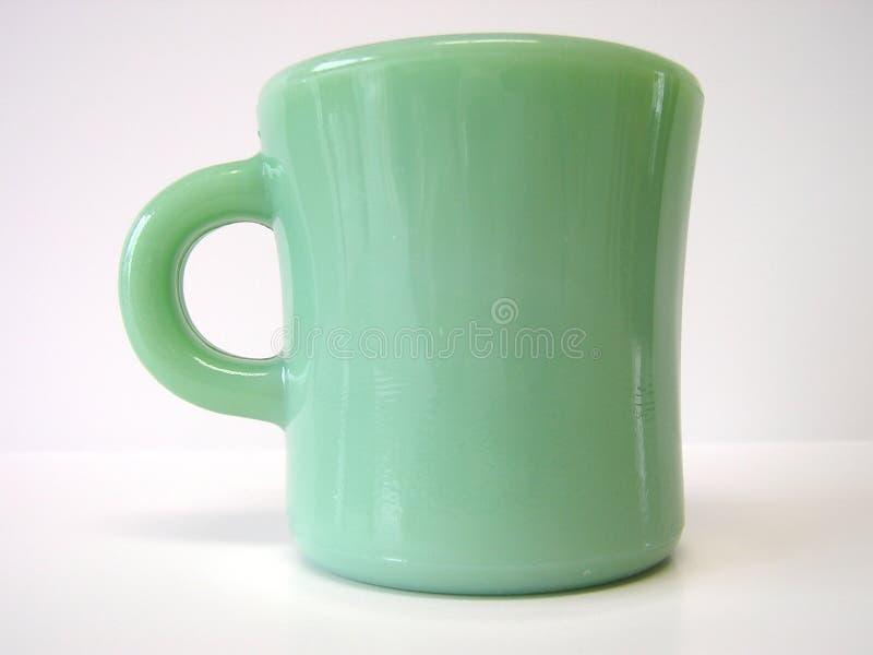 绿色杯子 库存照片