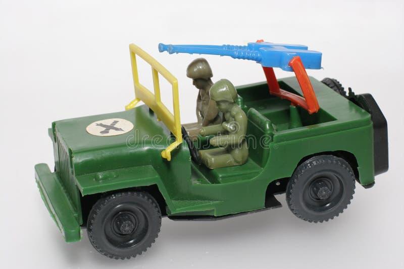 绿色枪吉普军人戏弄 库存照片