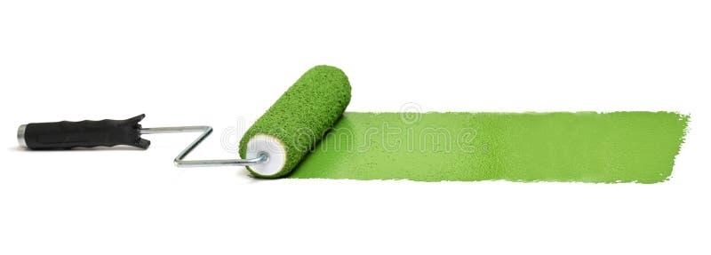 绿色漆滚筒 免版税库存照片