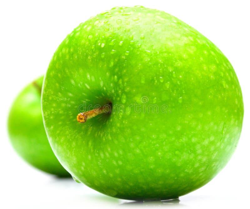 绿色的苹果弄湿了 免版税库存图片