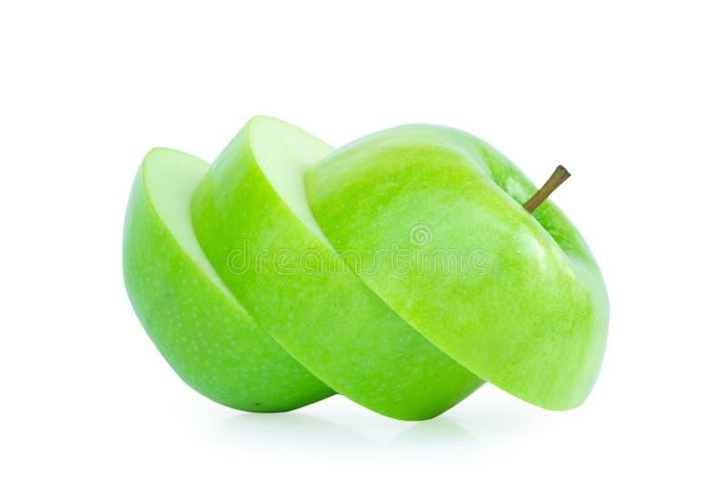 绿色苹果切片在白色背景,果子健康浓缩solated 库存照片