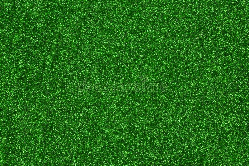 绿色被遮蔽的云杉织地不很细闪烁背景 发光的闪耀的背景 免版税库存图片