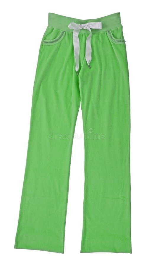 绿色裤子炫耀长裤 免版税图库摄影