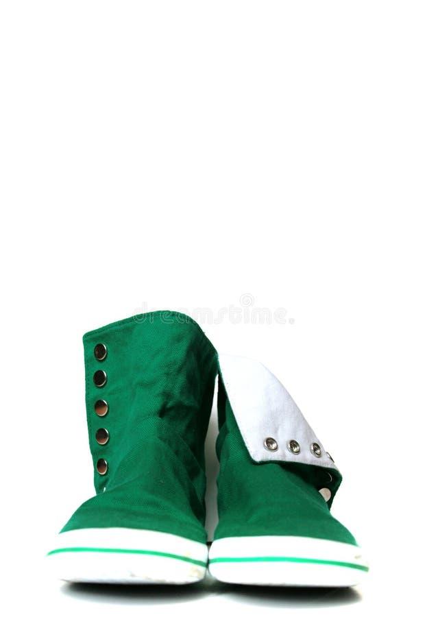 绿色运动鞋 库存照片