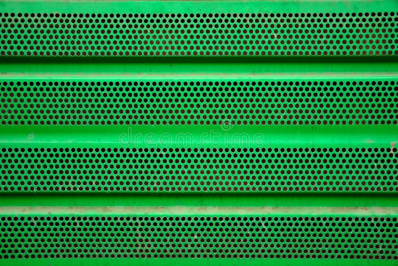 绿色金属格栅背景,铁涂层 库存图片