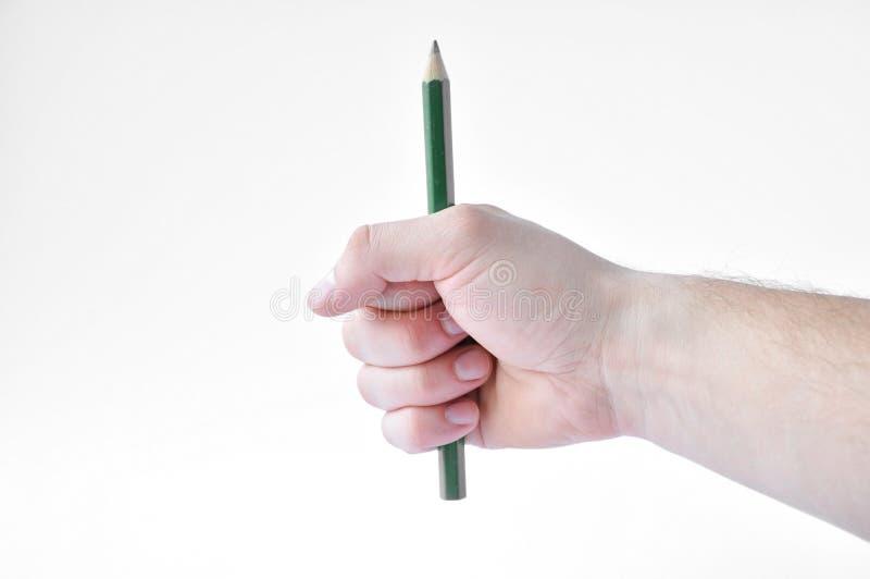 绿色铅笔在手中 免版税库存图片