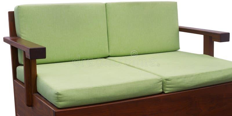 绿色长沙发 免版税库存照片