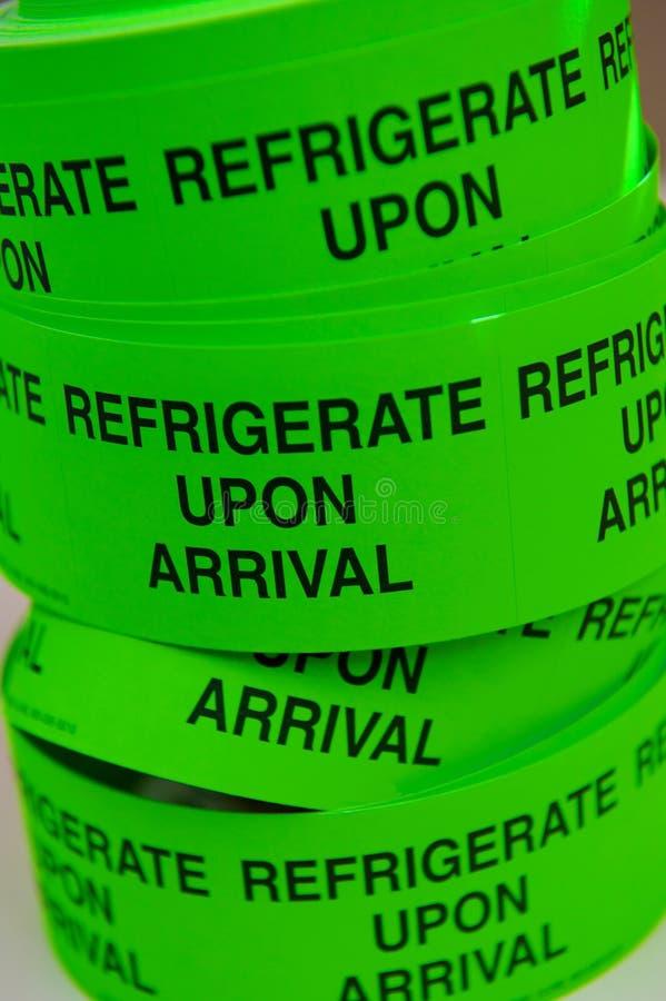 绿色霓虹卷磁带 库存图片