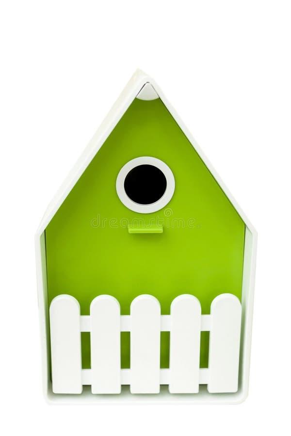 绿色鸟的议院在白色背景的 鸟的鸟舍 库存照片