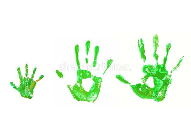 绿色handprints婴孩,父亲,母亲,生态概念。 免版税库存图片