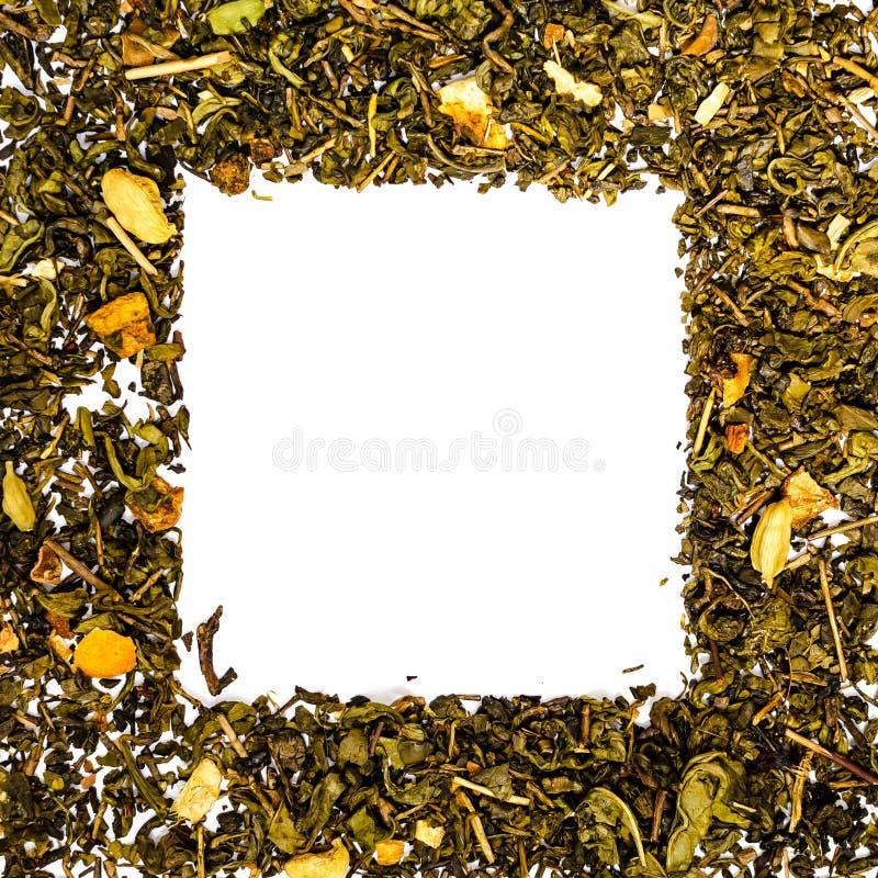 绿茶方形的框架用豆蔻果实 免版税库存照片
