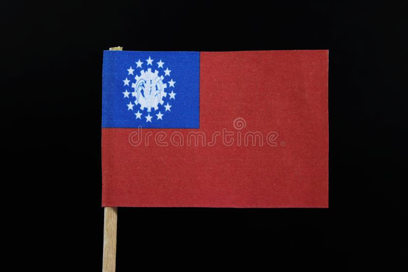 缅甸的一面老正式旗子牙签的在黑背景 缅甸联邦的社会主义共和国旗子  免版税库存照片