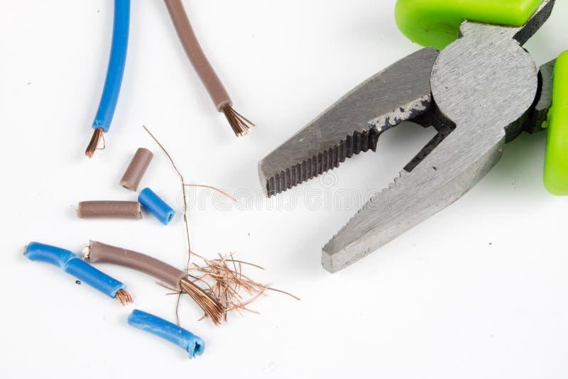 缆绳切削刀和被绝缘的电导线 辅助部件为选举 库存图片