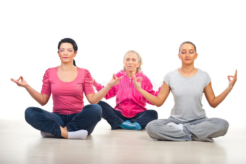 编组位置女子瑜伽 免版税库存图片