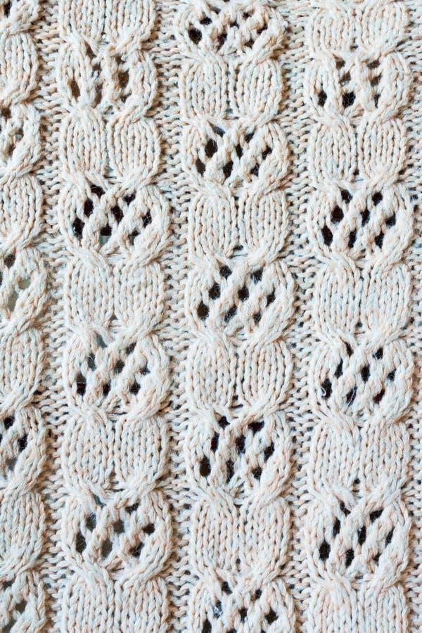 编织从羊毛有透雕细工样式背景 免版税库存图片